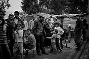 """The gypsy community at the camp.<br /> <br /> The gipsies call it """"the Cult"""", it is a kind of pact that they get together twice a week in a common hut to pray for good and exorcise the evil. Inside the hut there´s a heavy atmosphere and things seem to be a blend of fantasy and reality. Tens of gipsies form a circle of screams and cries and you can hear a mix of prays, complains, desperation and guilt. A gipsie women faints on the floor almost like she has been exorcised and she had a demon inside her, slowly with the help of the others she recovers.<br /> The truth is that the cult is a way that gipsies chose to express themselves, something that is very much theirs, just like the sound of the gipsies guitars, shows something very real, the suffering of their spirits."""