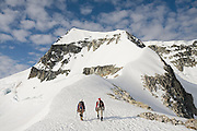 Climbers Jim Prager and Obadiah Reid ascend the NE Arete of Wedge Mountain in Garibaldi Provincial Park, British Columbia, Canada on June 14, 2009. Wedge (2892 m) is the highest summit in the park.