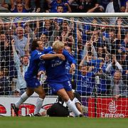 Chelsea's Gianfranco Zola celebrates their opening goal with scorer Eidur Gudjohnsen
