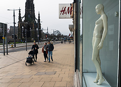 Edinburgh, Scotland, UK. 24 Feb 2021. As the UK and Scottish Governments outline rough timelines to ease the current lockdown , retailers and businesses remain close in UK city centres. Normally busy Princes Street remains eerily deserted with virtually all shops closed. Pic; naked mannequin looks out onto Princes Street from Top Shop which has now closed. Iain Masterton/Alamy Live News