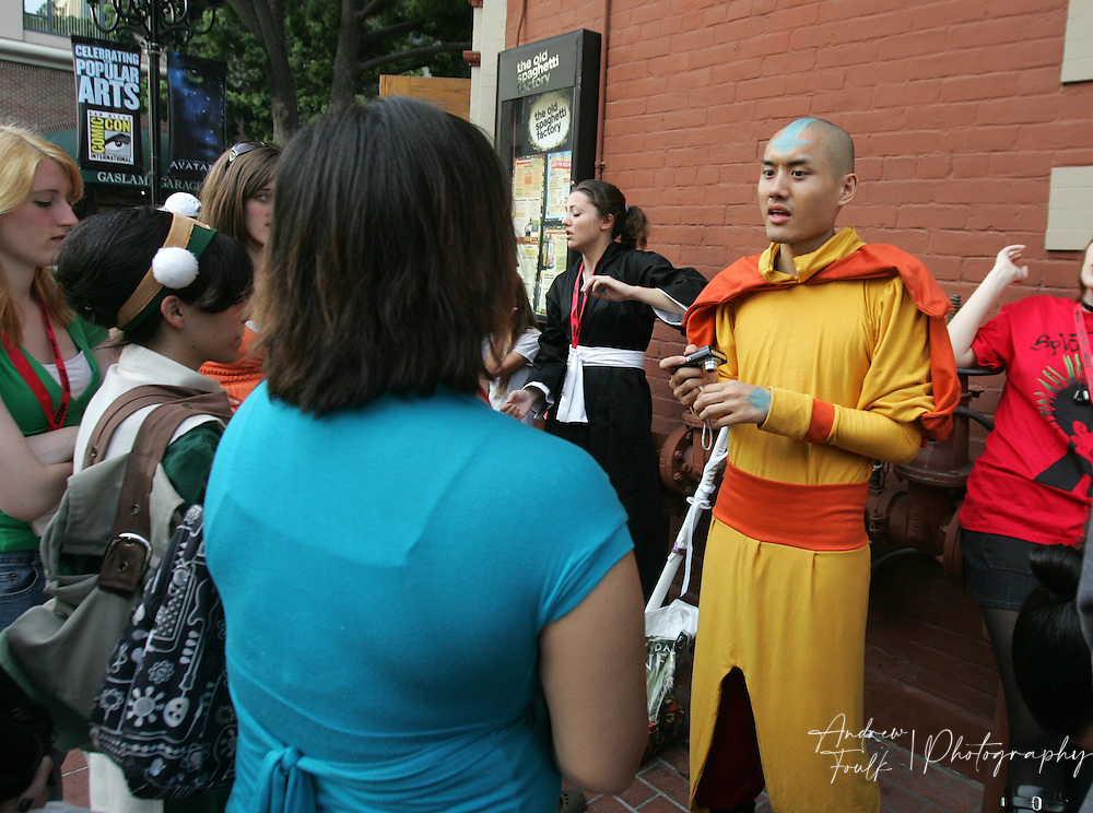 """Andrew Foulk/ Zuma Press.July 24, 2009, San Diego, California, USA. Comic Con. A group of  """"Amime"""" fans talk outside a restaurant in the """" Gaslamp Quarter of San Diego, after leaving day two of the 40th annual San Diego International Comic Con."""