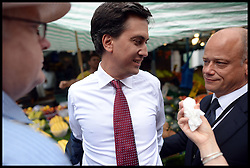 Ed Miliband being egged..Ed Miliband East Street Market Visit. Labour leader Ed Miliband being egged by a member of public during a  living standards related visit to South East London's East Street Market.  This is Milliband's first official visit since coming back from holiday, <br /> East Street Market, London, United Kingdom. Wednesday, 14th August 2013. Picture by Andrew Parsons / i-Images