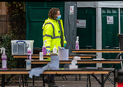 © Licensed to London News Pictures. 02/02/2021. London, UK. Staff prepare a Covid testing centre in a high risk area of Hanwell as the Covid-19 South African variant spreads across London. Yesterday, two people tested positive in Woking, Surrey for the South African variant by community transmission with no links to South Africa as 80,000 people in the South East will be offered urgent Covid-19 tests as Health Minister Matt Hancock urged residents in high risk areas to take extra special precautions . Photo credit: Alex Lentati/LNP