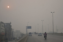 November 1, 2016 - Lahore, Punjab, Pakistan - A view of the first  fog weather seen. Fog blankets in Lahore reducing visibility,which covered several parts of Punjab. The fog continued in the grip of foggy weather on Tuesday, hampering the routine life as less-visibility caused slowing down of vehicular movement. (Credit Image: © Rana Sajid Hussain/Pacific Press via ZUMA Wire)