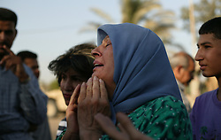 An Iraqi woman cries outside the UN base at the Canal Hotel where a cement truck packed with explosives detonated outside the offices killing 20 people and devastating the facility in Baghdad, Iraq on Aug. 19, 2003. This was an unprecedented suicide attack against the world body with at least 100 people wounded.