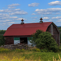 Trout Run, PA, USA- July 14, 2011: A secnic barn with a red roof in Pennsylvania Mountains