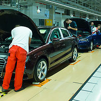 Workers assemble cars belonging to the Audi TT family in the Audi factory in Gyor (about 120 km West of Budapest), Hungary on November 05, 2014. ATTILA VOLGYI