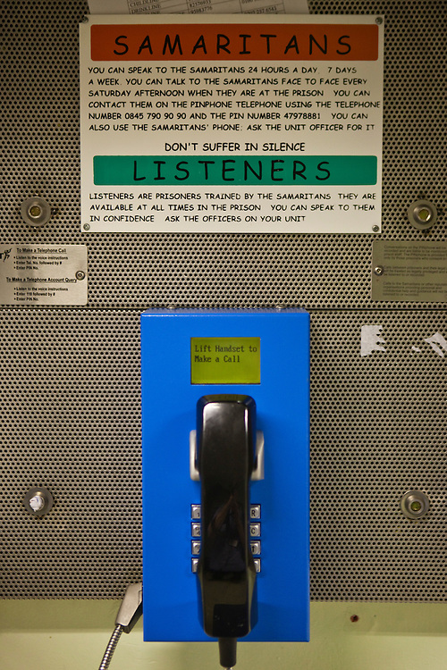 One of the prisoner use telephones atHMP Holloway, the main womens prison in London.