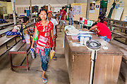 20 MAY 2013 - MAE KASA, TAK, THAILAND: People leave the MSRU clinic in Mae Kasa at the end of the day. Health professionals are seeing increasing evidence of malaria resistant to artemisinin coming out of the jungles of Southeast Asia. Artemisinin has been the first choice for battling malaria in Southeast Asia for 20 years. In recent years though,  health care workers in Cambodia and Myanmar (Burma) are seeing signs that the malaria parasite is becoming resistant to artemisinin. Scientists who study malaria are concerned that history could repeat itself because chloroquine, an effective malaria treatment until the 1990s, first lost its effectiveness in Cambodia and Burma before spreading to Africa, which led to a spike in deaths there. Doctors at the Shaklo Malaria Research Unit (SMRU), which studies malaria along the Thai Burma border, are worried that artemisinin resistance is growing at a rapid pace. Dr. Aung Pyae Phyo, a Burmese physician at a SMRU clinic just a few meters from the Burmese border, said that in 2009, 90 percent of patients were cured with artemisinin, but in 2010, it dropped to about 70 percent and is now between 55 and 60 percent. He said the concern is that as it becomes more difficult to clear the parasite from a patient, progress that has been made in combating malaria will be lost and the disease could make a comeback in Southeast Asia.    PHOTO BY JACK KURTZ