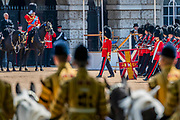 The Guards regiments march past in slow and quick time and Prince Andrew salutes their colours - The parade on Horse Guards - His Royal Highness the Duke of York reviews the final rehearsal for the Trooping the Colour on Horseguards Parade and the Mall.