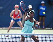 SLOANE STEPHENS hits a volley during her semifinal doubles match with partner Eugenie Bouchard at the Citi Open at the Rock Creek Park Tennis Center in Washington, D.C.