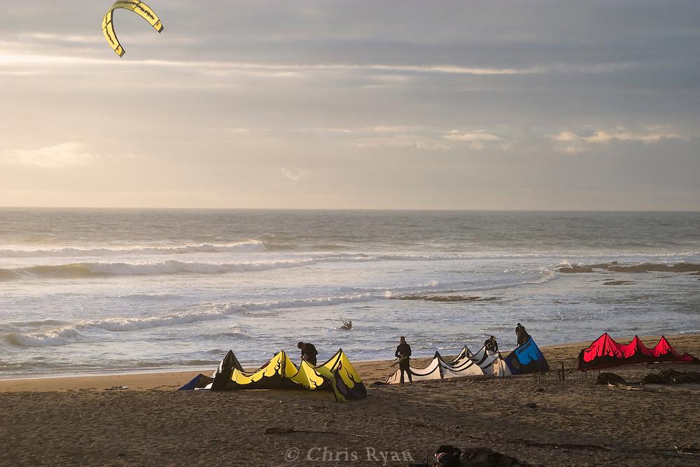 Kitesurfers on beach
