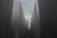 View toward a building from withing the Berlin Holocaust Memorial. More formally called The Memorial to the Murdered Jews of Europe, it was inaugurated in 2005.