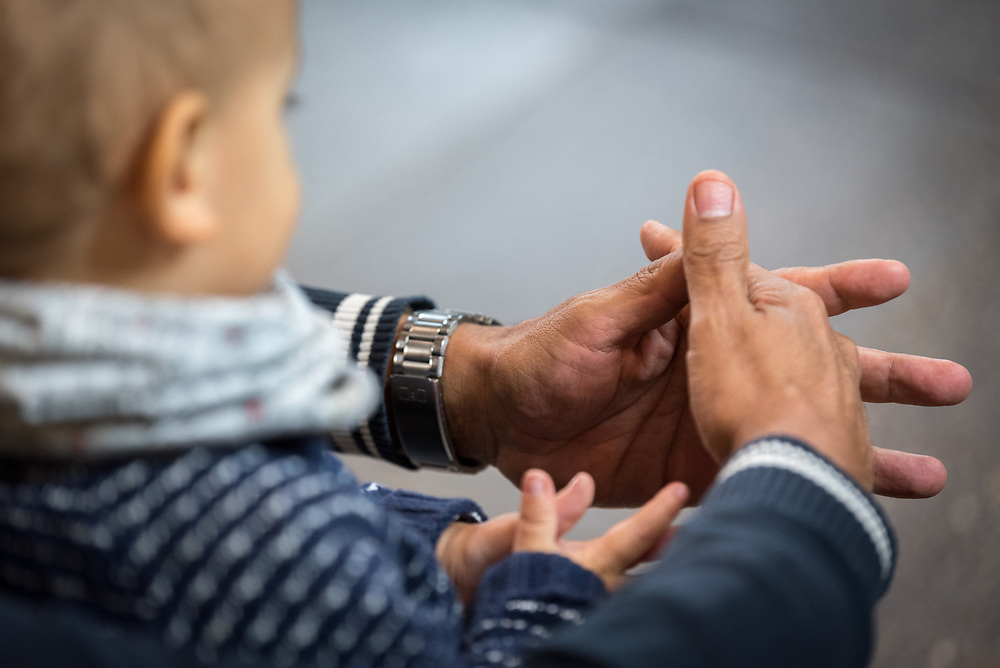 1 December 2019, Madrid, Spain: A father and son fold their hands as if in prayer, as representatives of various faiths gather in the Iglesia de Jesús (Church of Christ) of the Iglesia Evangélica Española (Evangelical Church of Spain) for an interfaith dialogue and prayer service on the eve of the United Nations climate conference (COP25) in Madrid, Spain.