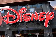 Sign for the media brand Disney Store on 19th December 2020 in London, United Kingdom. The Walt Disney Company, commonly known as Walt Disney or simply Disney, is an American diversified multinational mass media and entertainment conglomerate.