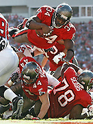 [PHOTO # 11 ]  <br /> <br /> 12 16 2007 - TAMPA - Bucs running back Earnest Graham (34) dives over the pile to score a touchdown in the second quarter.<br /> <br /> BRIAN CASSELLA | Times<br /> <br /> NFL FOOTBALL - Tampa Bay Buccaneers vs Atlanta Falcons at Raymond James Stadium on Sunday (12/16/07).