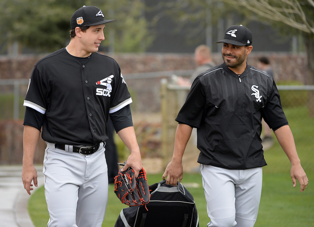 GLENDALE, ARIZONA - FEBRUARY 18:  Derek Holland #45 (L) and Geovany Soto #18 of the Chicago White Sox share a light moment during spring training workouts on February 18, 2017 at Camelback Ranch in Glendale Arizona.  (Photo by Ron Vesely)   Subject:  Derek Holland; Geovany Soto