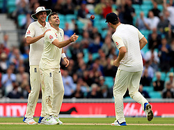 England's James Anderson (centre) celebrates catching and bowling out South Africa's Chris Morris (not in picture) during day two of the 3rd Investec Test match at the Kia Oval, London.