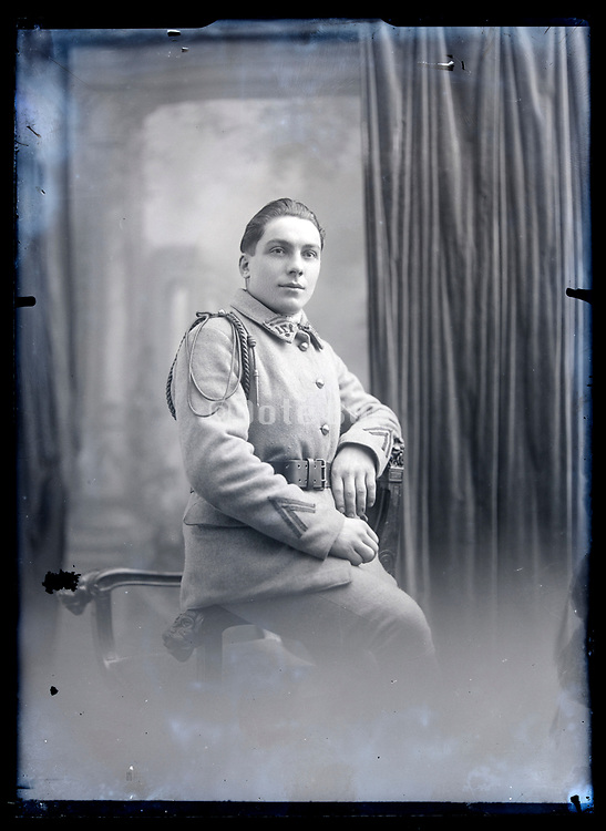 studio portrait of a man in military uniform France circa 1920s