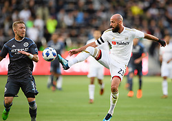 May 13, 2018 - Los Angeles, CA, U.S. - LOS ANGELES, CA - MAY 13: Los Angeles FC defender Laurent Ciman (23) goes high for a ball during the game between New York City FC and the Los Angeles FC on May 13, 2018, at Banc of California Stadium in Los Angeles, CA. (Photo by David Dennis/Icon Sportswire) (Credit Image: © David Dennis/Icon SMI via ZUMA Press)