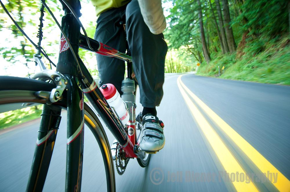 A cyclist trains on a rural highway near Portland, Oregon.