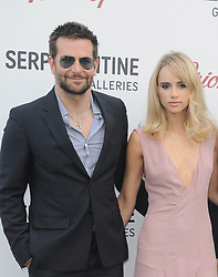 July 1, 2014 - London, England, United Kingdom - Bradley Cooper and Suki Waterhouse attend the annual Serpentine Gallery Summer Party at the Serpentine Gallery. (Credit Image: © Ferdaus Shamim/ZUMA Wire)