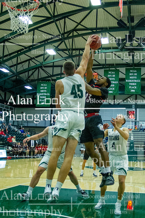 BLOOMINGTON, IL - November 12: Cody Mitchell rejects a shot by Nigel Ferrell during a college basketball game between the IWU Titans  and the Blackburn Beavers on November 12 2019 at Shirk Center in Bloomington, IL. (Photo by Alan Look)