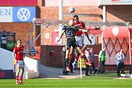 Ethan Pinnock of Barnsley (5) rises above Sam Smith of Shrewsbury Town (17) during the EFL Sky Bet League 1 match between Barnsley and Shrewsbury Town at Oakwell, Barnsley, England on 19 April 2019.