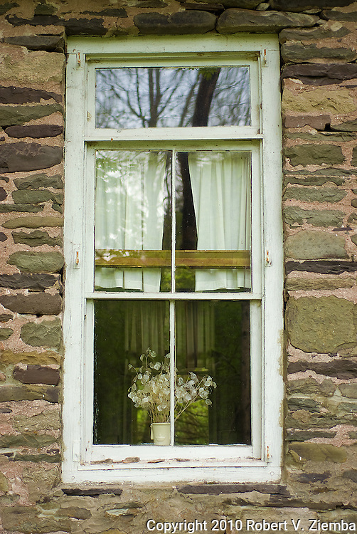 """""""Dunraven School House Window""""-An image of a window in a stone one room school house with reflections."""