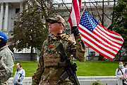 April 20, 2020 -- An armed protester in camouflage protests Pennsylvania Governor Tom Wolf's shutdown order during the COVID-19 pandemic.