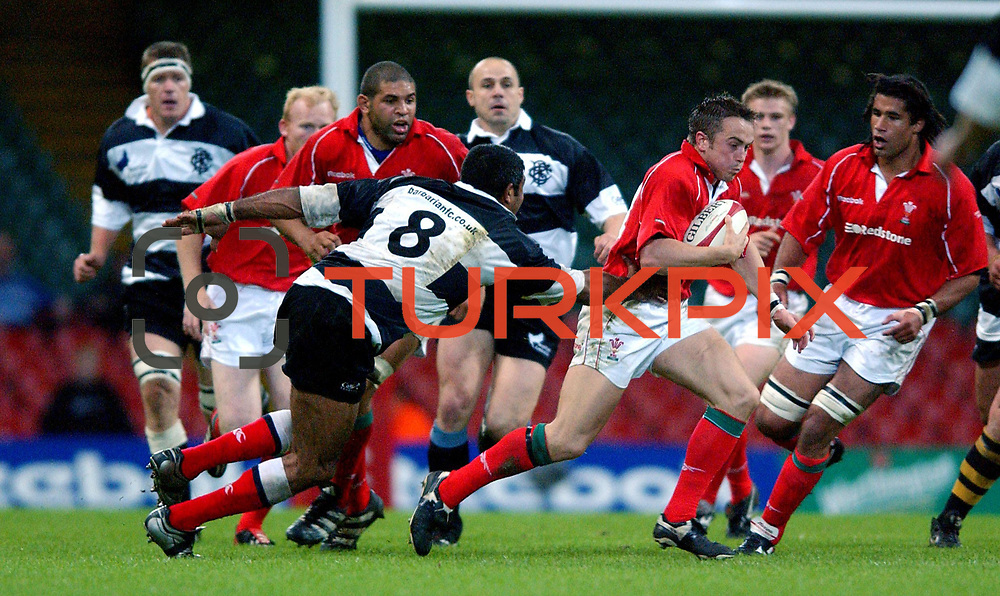 Wales' Rhys Williams (c) hands off the Barbarians' Jim Williams