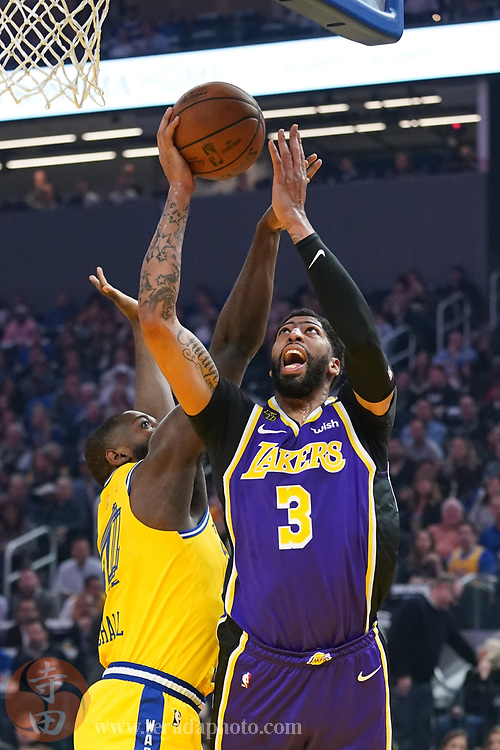 February 27, 2020; San Francisco, California, USA; Los Angeles Lakers forward Anthony Davis (3) shoots the basketball against Golden State Warriors forward Eric Paschall (7) during the first quarter at Chase Center.