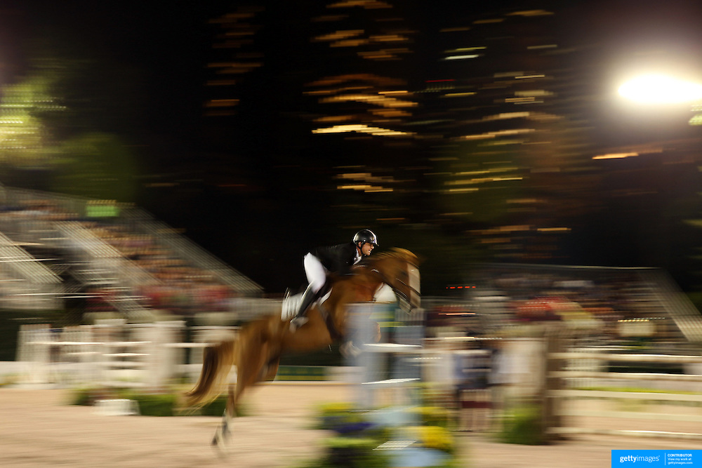 Charlie Jayne, USA, riding Valeska, in action during the $210,000 Central Park Show Jumping Grand Prix held in the Wollman Ice Rink. The event was part of the four Day Central Park Horse Show. Central Park, Manhattan, New York, USA. 18th September 2014. Photo Tim Clayton
