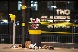 © Licensed to London News Pictures . 07/04/2017 . Manchester , UK . A waste bin overflowing with rubbish in St Peter's Square . Greater Manchester Police have authorised dispersal powers and say they will ban people from the city centre for 48 hours , this evening (7th April 2017) , in order to tackle alcohol and spice abuse . Photo credit : Joel Goodman/LNP
