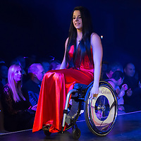 Winner Fanni Illes of Hungary rolls on the catwalk during the Miss Colours International wheelchair beauty contest in Budapest, Hungary on March 22, 2014. ATTILA VOLGYI