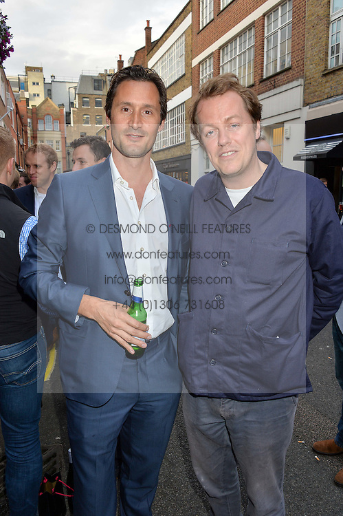 Left to right, TRISTAN HOARE and TOM PARKER BOWLES at a private view of photographs by Jolyon Fenwick 'The Zero Hours Panoramas' 100 Years On: Views From The Parapet of The Somme held at Sladmore Contemporary, 32 Bruton Place, London on 30th June 2016.