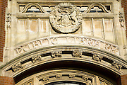Detail of stonework above entrance to Ipswich public library, Suffolk, England