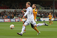 Sean Rigg of Wimbledon is challenged by Robbie Willmott of Newport. Skybet football league two match, Newport county v AFC Wimbledon at Rodney Parade in Newport, South Wales on Saturday 27th Sept 2014<br /> pic by Mark Hawkins, Andrew Orchard sports photography.