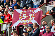 Hearts fans with a 5-1 flag during the Cinch SPFL Premiership match between Heart of Midlothian and Hibernian at Tynecastle Park, Edinburgh, Scotland on 12 September 2021.