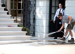 Contractor works on the newly renovated steps of the South Portico of the White House in Washington, DC, USA, on Tuesday, August 22, 2017. Photo by Ron Sachs/CNP/ABACAPRESS.COM