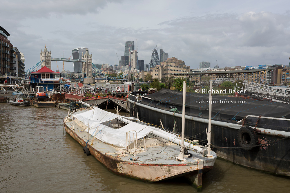 Private boats and water vessels at Tower Bridge Moorings, on 6th September 2017, in London, England.