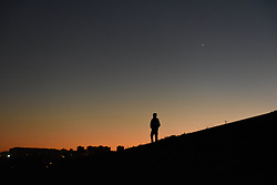 November 14, 2016 - Madrid, Madrid, Spain - A man waits for to see the supermoon over the city of Madrid. (Credit Image: © Jorge Sanz/Pacific Press via ZUMA Wire)