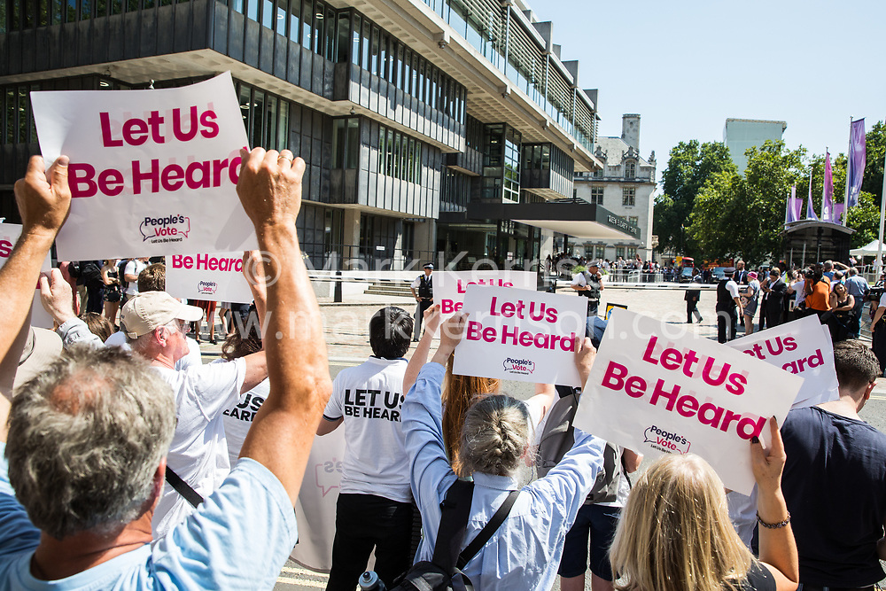 London, UK. 23 July, 2019. Campaigners for a People's Vote protest outside the Queen Elizabeth II Centre prior to the announcement inside the venue that Boris Johnson had been elected as leader of the Conservative Party and would replace Theresa May as Prime Minister.