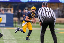 Nov 23, 2019; Morgantown, WV, USA; West Virginia Mountaineers quarterback Jarret Doege (2) runs out of the pocket during the first quarter against the Oklahoma State Cowboys at Mountaineer Field at Milan Puskar Stadium. Mandatory Credit: Ben Queen-USA TODAY Sports