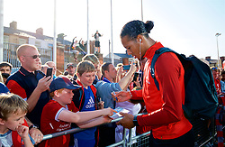 BLACKBURN, ENGLAND - Thursday, July 19, 2018: Liverpool's Virgil van Dijk signs autographs for supporters as he arrives at the stadium before a preseason friendly match between Blackburn Rovers FC and Liverpool FC at Ewood Park. (Pic by Paul Greenwood/Propaganda)