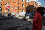 Children walk though a street intersection in the Erdaojiang district in Tonghua, Jilin province, China, on Wednesday, Jan. 6, 2016. The citys once-vaunted state-run steel mills have slipped inexorably into decline, weighed down by slumping global markets, a changing economy, and the burden of costs and responsibilities to the people of the town they fostered. Previous attempts to privatise the enterprise have met with stiff resistance, one such attempt resulted the mob lynching and death of a private businessman who wanted to invest and streamline the operation.