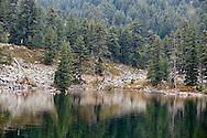 Reflections on Hridsko jezero, Peaks of the Balkans trail, Montenegro © Rudolf Abraham