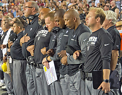 "Oakland Raiders coaches stand with locked arms in solidarity as the National Anthem is sung prior to the game against the Washington Redskins at FedEx Field in Landover, Maryland on Sunday, September 24, 2017. The Raiders chose to demonstrate prior to their nationally televised contest following tweets earlier in the day from United States President Donald J. Trump urging owners to ""fire or suspend"" players who participated in the protests by not standing for the anthem. Photo by Ron Sachs/CNP/ABACAPRESS.COM"