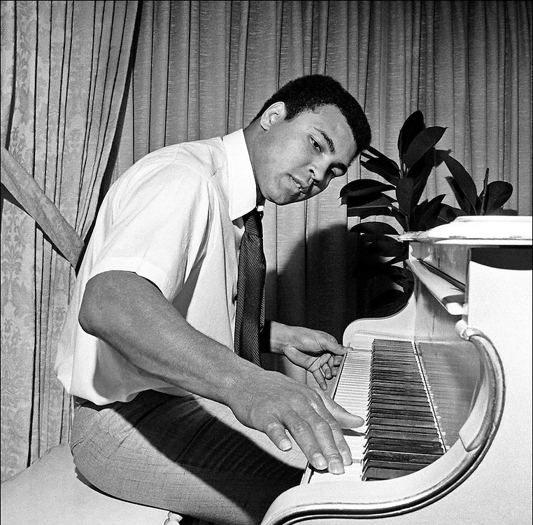 Muhammad Ali also known as Cassius Clay and 'The Greatest'. Heavyweight boxing champion seen playing his piano at his home in Chicago, USA in 1977. Photographed by Terry Fincher
