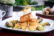 Potato crusted halibut over mushroom, onion and cheese quiche, brussels sprouts sauteed in duck fat and bacon, deviled egg and a tabasco cream sauce. (Artisan Image © 2013)